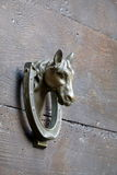 Door knocker on the old brown wooden door Royalty Free Stock Images