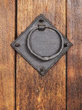 Door knocker. Old door knocker on wooden door Royalty Free Stock Photos