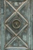 Door knocker. In an old wooden door royalty free stock image