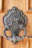 Door knocker. An ornate door knocker on the front door stock photography