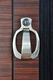 Door knocker with peep hole. Wooden doors and metal door handle Stock Images