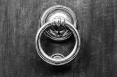 Door knocker with ring. Black and white photo Royalty Free Stock Photos