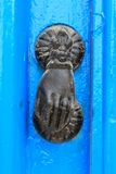 Door knocker in the shape of a hand close-up Royalty Free Stock Photography