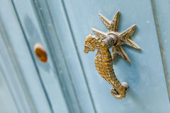 Door knocker. A door knocker in the shape of seahorse on a blue door of a Maltase house in the old city of Mdina Royalty Free Stock Images