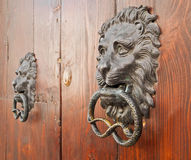 Door knockers on ancient portal. Royalty Free Stock Photos
