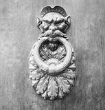 Door Knockers close up on a door, Siena, Tuscany, Italy (black and White) royalty free stock images