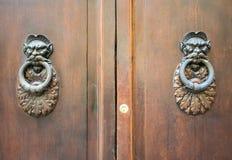 Door Knockers on a door, Siena, Tuscany, Italy Royalty Free Stock Images