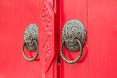 Door knockers on the red door Stock Image