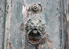Door knoker on an old wodden door Royalty Free Stock Photo