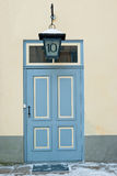 Door and lantern Stock Images