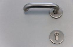 Door latch. Closeup of door latch with lock Royalty Free Stock Images