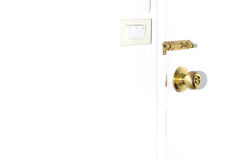 Door and latch. Golden knob and latch on white door Stock Images