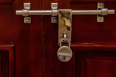 Door Latch On Wooden Surface And Lock Royalty Free Stock Photos