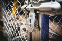 Door latches with an old metal fence net. Stock Photos