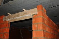 Door lintel. Building house construction. Door concrete lintel with unfinished house construction. Royalty Free Stock Photo