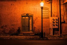 Door Lit by Lamp Post Royalty Free Stock Photography