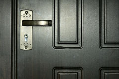 Door and lock. The close-up of iron door and lock Royalty Free Stock Photography