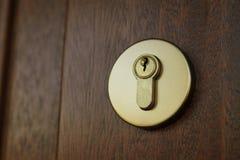 Door lock. Wooden door lock and keyhole. Security concept royalty free stock photos