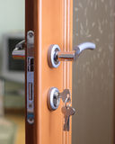 Door lock. A hotel room door lock and key Royalty Free Stock Images