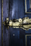 Door lock. Ancient gold door lock on blue door Stock Images