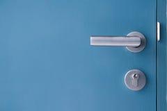 Door lock on blue door background. Blue wooden door Stock Photo