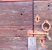 Door with lock and circle to knock Royalty Free Stock Image