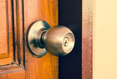 Door lock and door knob. Do not forget to lock the room, because the property may be lost Stock Photo