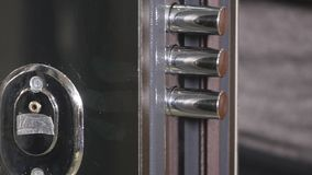 The door lock with the handle and a key.  stock video