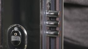 The door lock with the handle and a key.  stock footage