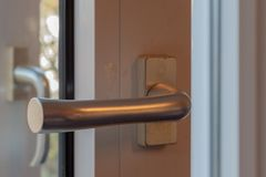Door lock with handle and key royalty free stock photos