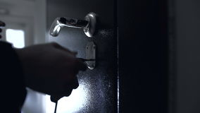 The door lock with the handle and a key. Sadness, sorrow, tragedy. dark view stock footage