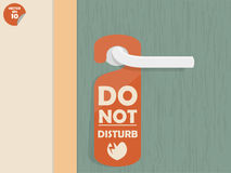 Door lock hanging room tag with text shown do not disturb Stock Image