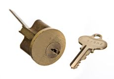 Door lock and house key. Door lock and key, isolated on white ground royalty free stock photography