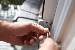 Door lock installation. Stock Photo