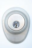 Door lock with keyhole. Close-up of metallic door lock with keyhole stock image