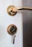 Door lock with keys installed Royalty Free Stock Image