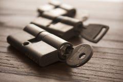 Door lock with keys. On wooden surface Stock Photos