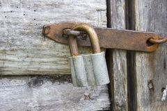 Door lock old rusty wooden background Stock Images