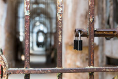 Door lock on rusty metal cell in old prison. Royalty Free Stock Photo