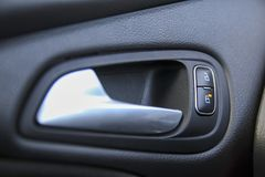 Door lock, unlock buttons and opener inside a car stock image