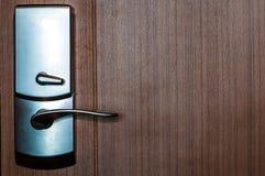 Door lock. Of wooden brown door Stock Photo