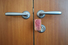Door locked by seal. Wooden door locked by seal Royalty Free Stock Photos
