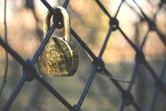 Door locks hanging on an iron grate Stock Photo