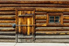 Door in log wall Royalty Free Stock Photography