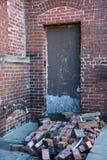 Door with loose bricks Royalty Free Stock Photos