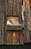 Door made of wood, ruined by the weather. stock photo
