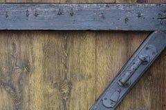 Metal handle. Door metal handle on a wooden fence Royalty Free Stock Images