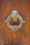 Door with metal knocker Royalty Free Stock Images