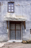Door and metallic facade of an old house, in Milia village, near Metsovo, Greece Stock Photo