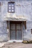 Door and metallic facade of an old house, in Milia village, near Metsovo, Greece Stock Photo